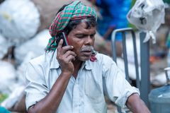 a old man while talking on her mobile phone stock photos