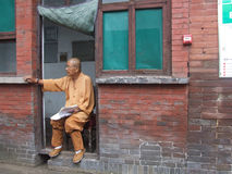 An old man in a temple. Stock Image