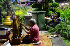 Old man thai people playing Angklung show traveler at Chiang Rai, Thailand. Stock Photo