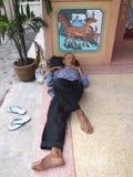 Old man, Thailand. BANGKOK, THAILAND - MAY 16: Thai old man sleeping outside a Chinese temple May 16, 2005 in Bangkok Stock Image
