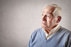 Old man thiking. Old man thinking and looking at his left stock photos