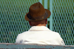 Old Man thinking. Old man thinks about horseraces royalty free stock images