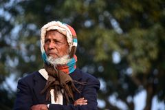 Poor old man portraits editorial photo. Poor man standing outdoor thinking about something royalty free stock photo