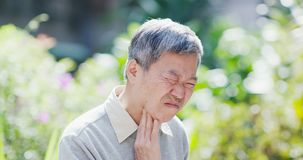 Old man throat pain stock photography