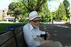 Old man sitting alone Stock Photo