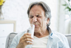 Old man with tooth sensitivity. Old man with  tooth sensitivity Royalty Free Stock Image