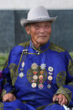 Old man in traditional clothes in Ulan Bataar Stock Images