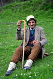 Old man in traditional hat and a stick in his hand Royalty Free Stock Image