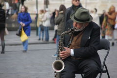 Old man with a trumpet. This Old man is making a living by playing his trumpet in the streets of Prague Royalty Free Stock Image