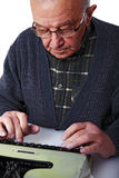 Old man and typewriter Royalty Free Stock Photo