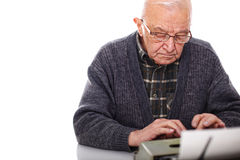 Old man and typewriter. Portrait of caucasian ol man and vintage typewriter Royalty Free Stock Photos