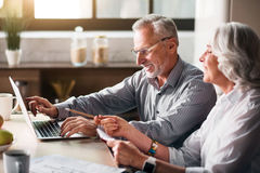 Old man typing while woman pointing at the screen royalty free stock image