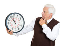 Old man under time pressure Stock Image