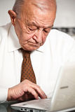 Old man use pc Stock Image