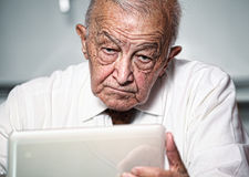 Old man use pc Stock Photography