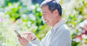 Old man use smart phone royalty free stock photo