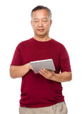 Old man use of tablet Stock Image