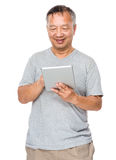 Old man use of tablet Stock Images