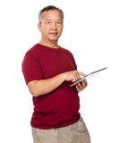 Old man use of tablet pc Royalty Free Stock Photo
