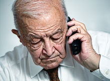 Old man use telephone Royalty Free Stock Photos