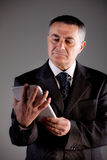 Old man using a digital tablet Stock Photography