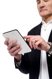 Old man using his tablet pc Royalty Free Stock Photography
