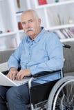 Old man using laptop Royalty Free Stock Photos