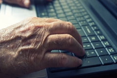 Old man using notebook Royalty Free Stock Image