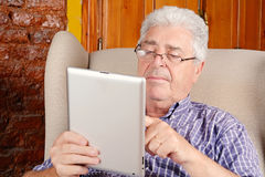 Old man using tablet. Stock Photos