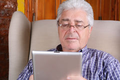 Old man using tablet. Stock Photo