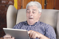 Old man using tablet. Stock Photography