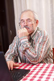 Old man using technology Royalty Free Stock Photos