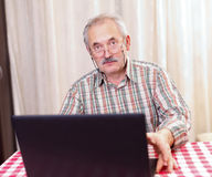 Old man using technology Stock Images