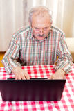 Old man using technology Stock Image