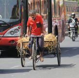 Old man using tricycle as a goods transport vehicle