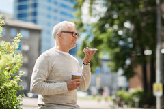 Old man using voice command recorder on smartphone Stock Image
