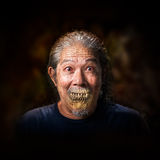 Old man vampire. Portrait of the old man vampire on dark background Stock Images
