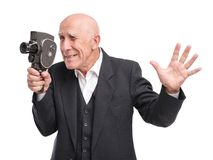 Old man with old video camera. royalty free stock photography