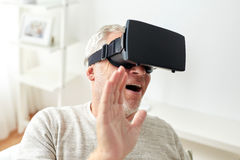 Old man in virtual reality headset or 3d glasses Stock Photos