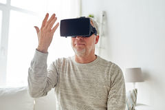 Old man in virtual reality headset or 3d glasses Stock Images