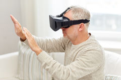 Old man in virtual reality headset or 3d glasses Royalty Free Stock Photography