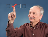Old man votes Stock Photography