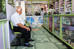 Old man waiting in pharmacy Royalty Free Stock Photo