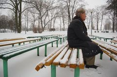 Old man waiting for somebody. Old man sitting on the bench in the park Stock Images