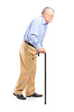 Old man walking with cane Stock Images