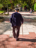 Old Man Walking in Park Stock Photography
