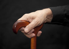 Old man with walking stick Stock Image
