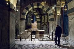Old man walking to the Karlsthron Throne of Charlemagne inside of the Chapel of Charlemagne Aachen Cathedral. The Roman Catholic Church in Germany, December 20 Stock Photos