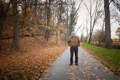 Old Man Walking on a Trail Royalty Free Stock Images
