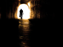 Old Man Walking Through Tunnel Royalty Free Stock Photography